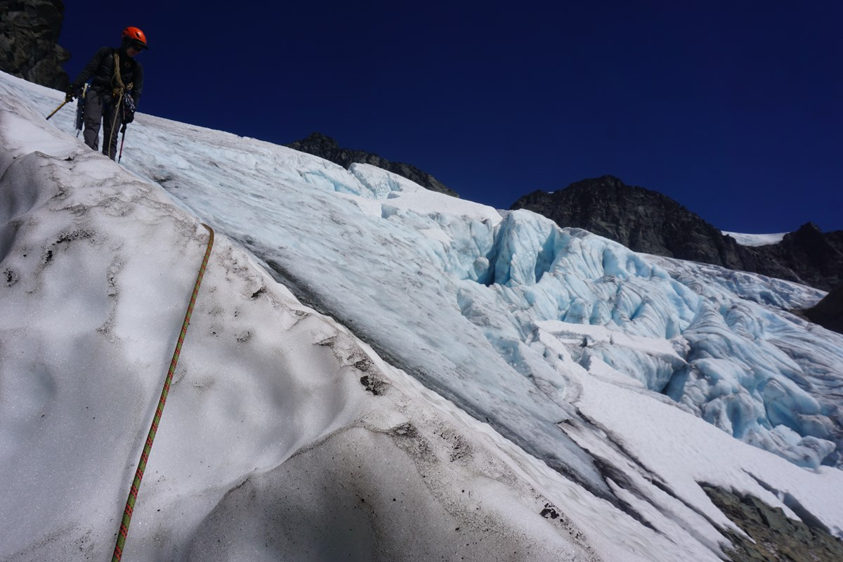 A North Cascades Ranger descends ice off of the Upper Curtis glacier