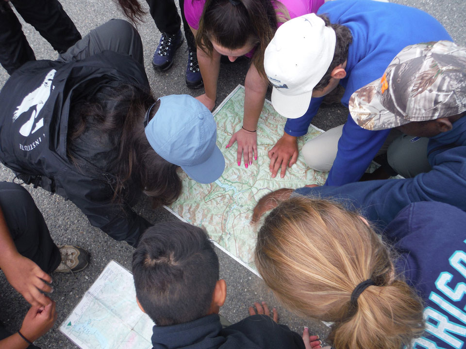 A group looks over a map of the park