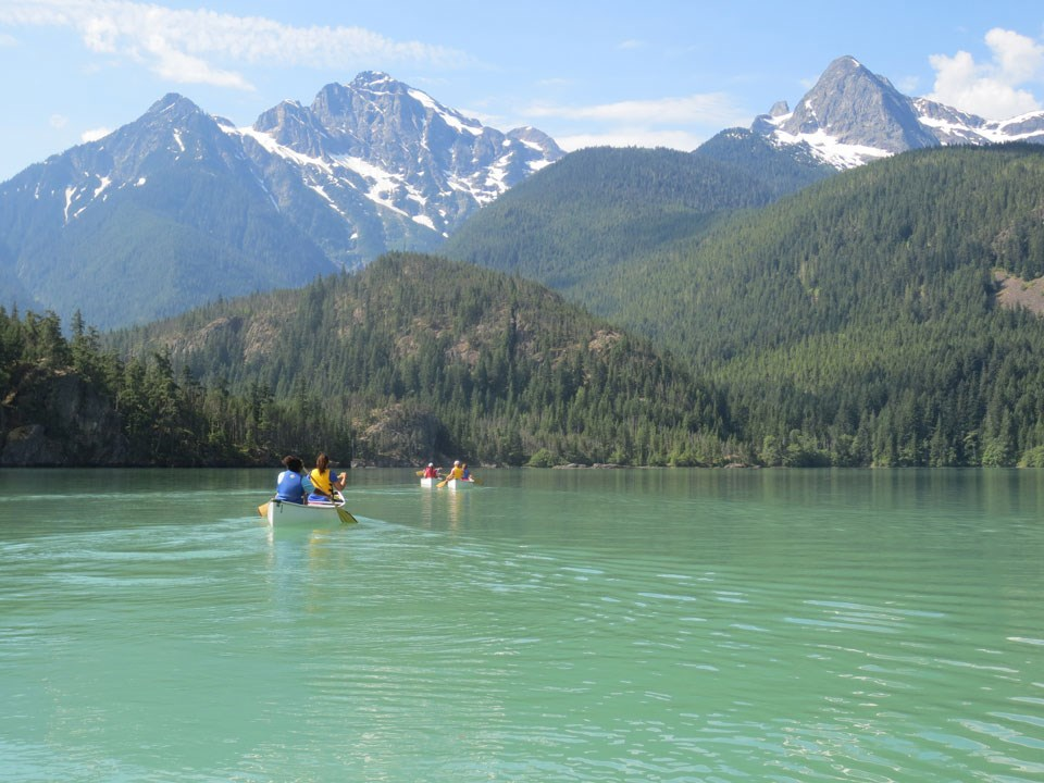 Canoers on turquoise waters of lake