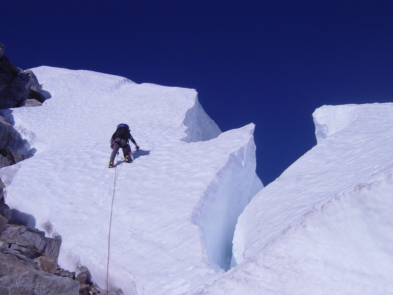 Climber passing crevasses on Challenger Peak