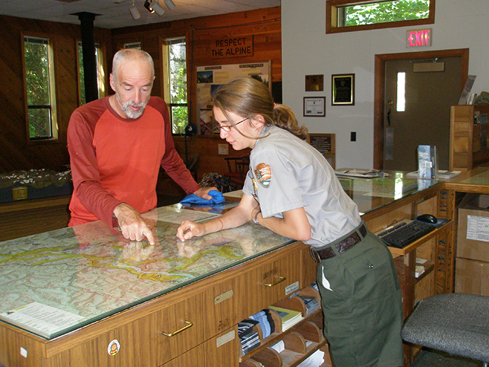 Rangers help visitors plan their trip at the Wilderness Information Center in Marblemount.
