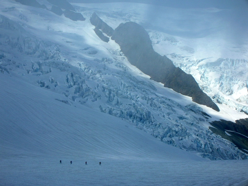 Four climbers crossing glacier