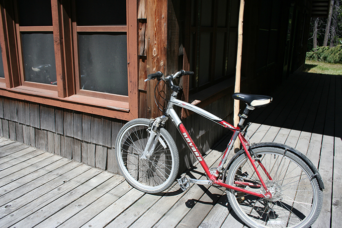 A bike is parked outside the Hozomeen staff housing complex. Image Credit: NPS/NOCA