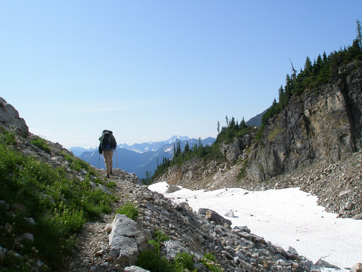 Hiker crossing Park Creek Pass