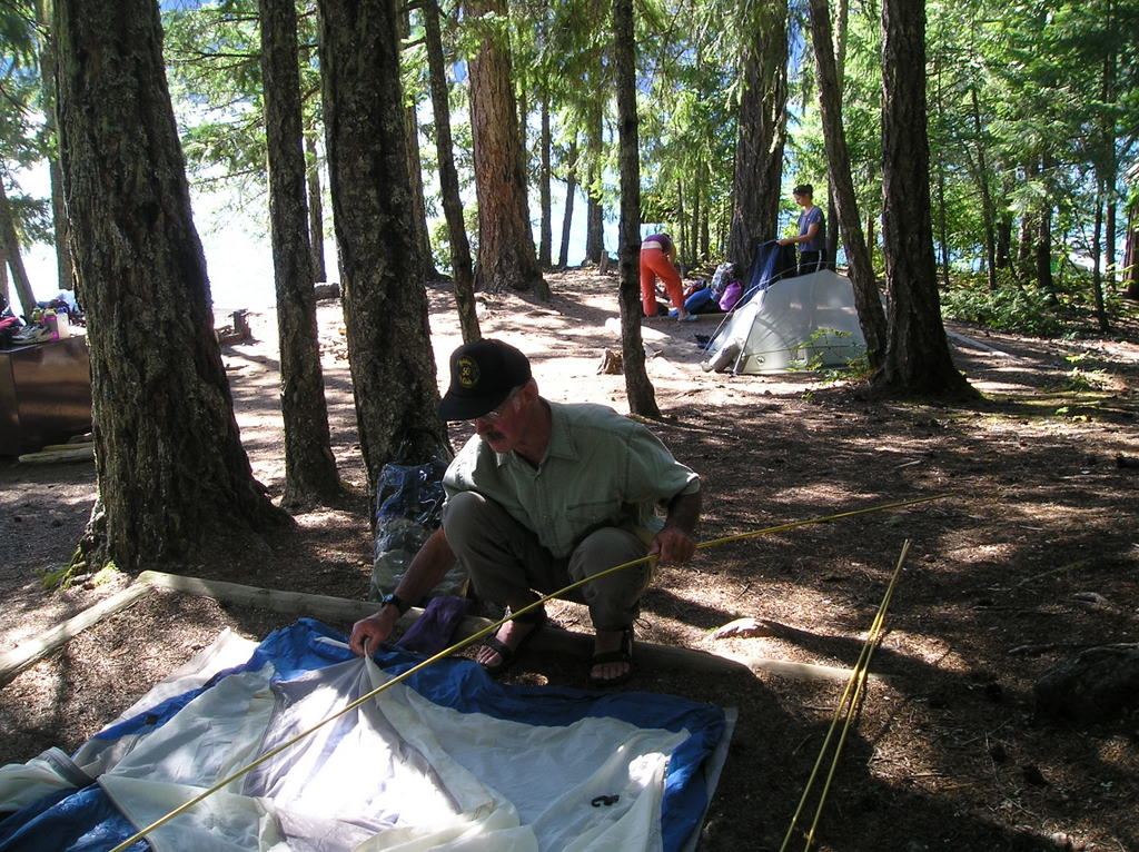 Campers setting up backcountry camp on Ross Lake