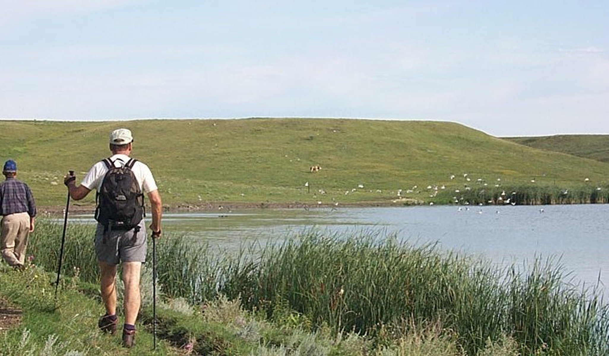 A Hiker along the shore of Lake Ashtabula, North Dakota