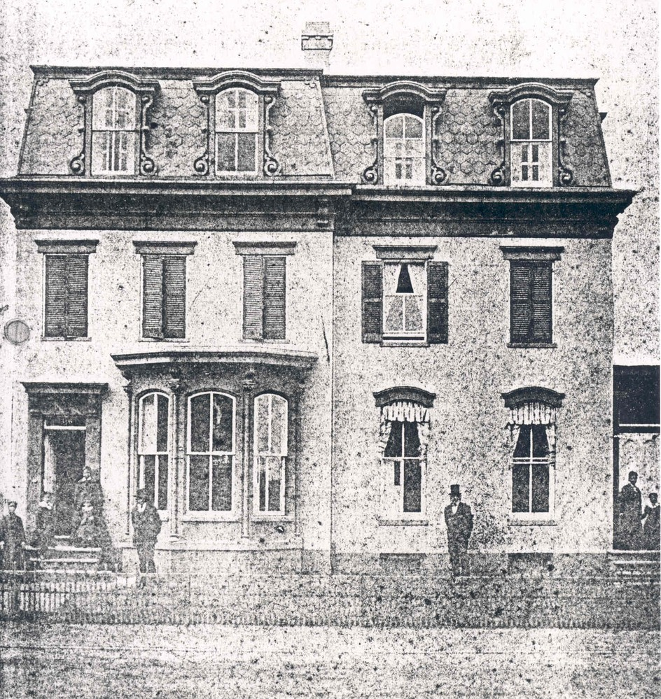 Frederick Douglass in front of his A Street NE home