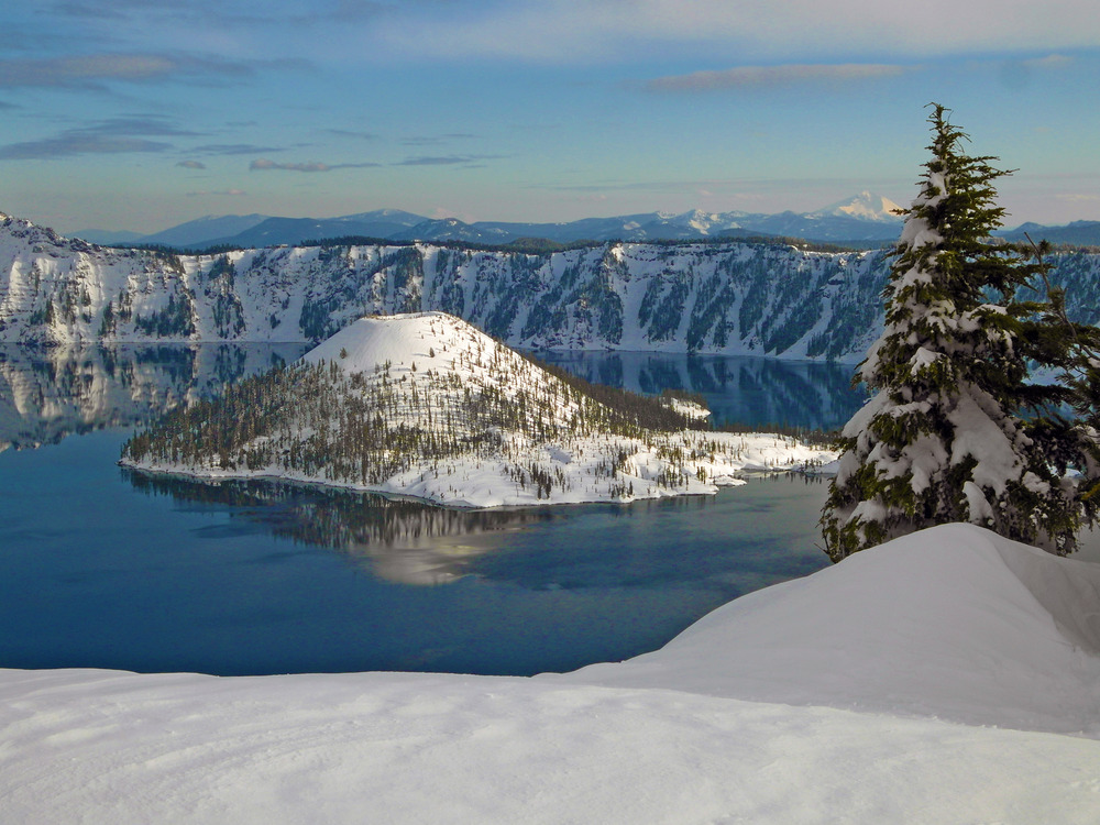 A view of Wizard Island covered in snow.