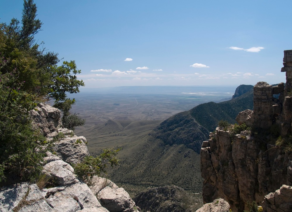 View of lower Pine Spring Canyon from Hunter Peak. Guadalupe Peak Trail visible on opposite ridge.