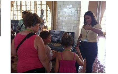 Emily- one of our interns- with visitors at Ellis Island
