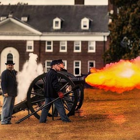 Re-enactors fire a cannon at Governors Island.