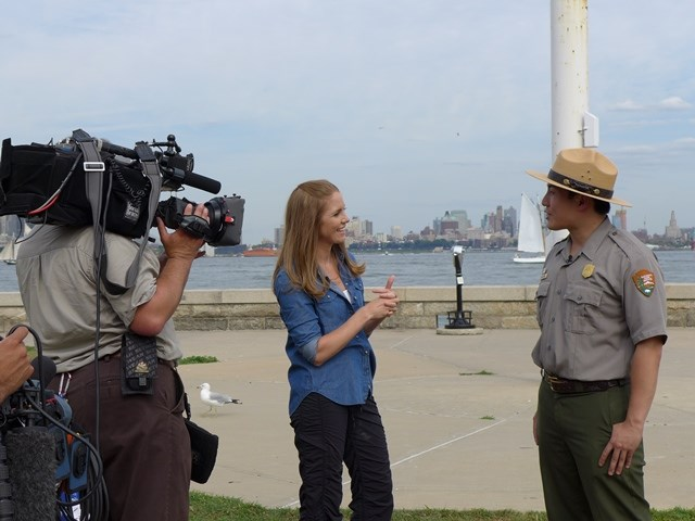 At Ellis Island, Park Ranger Peter Wong gives an interview.