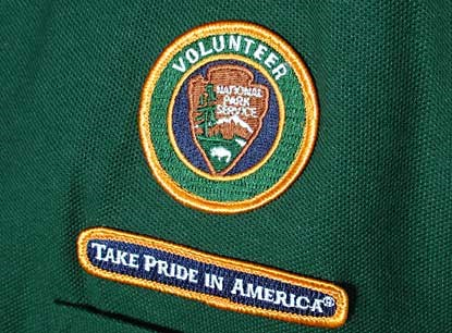 Uniform patch for the National Park Service Volunteer Program.