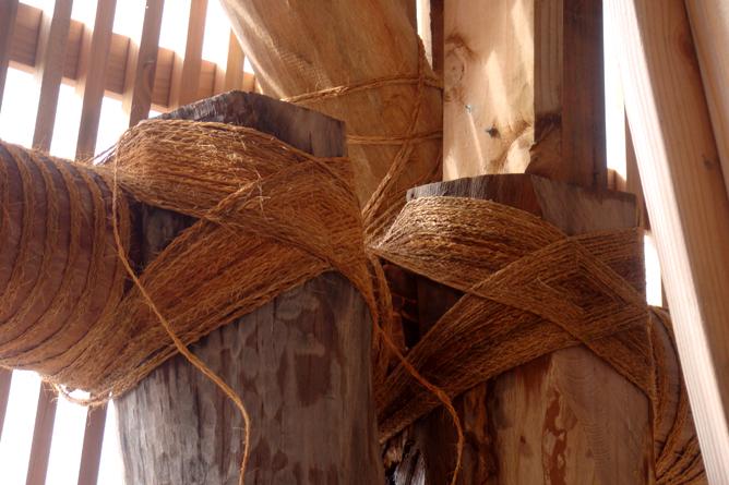 Hand-woven coil of coconut fibers -- sennit, used to tie up lumber used for fale framing structures.