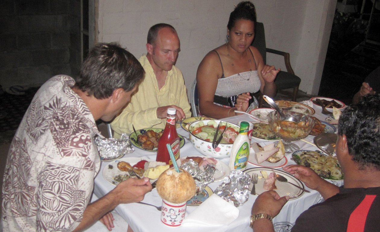Visitors enjoying a meal with a Home Stay family.