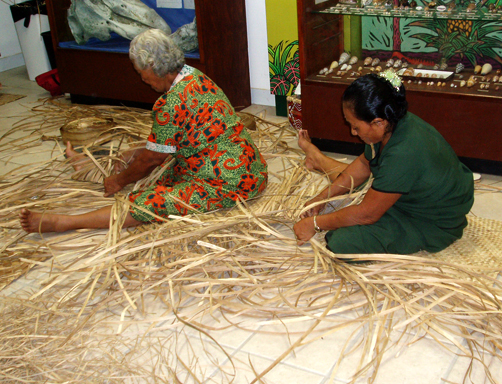 Samoan women weaving fine mats.