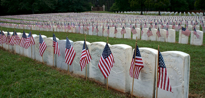 Photo of flags and headstones at Andersonville National Cemetery