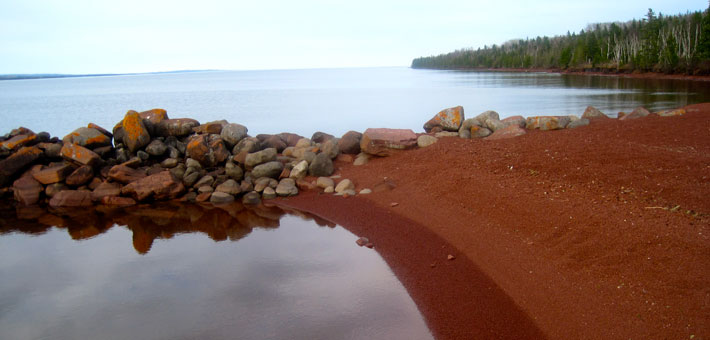 Photo of the red beach at Siskiwit Bay campground