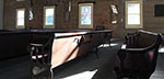 Old, wooden benches line the interior of Wesleyan Chapel