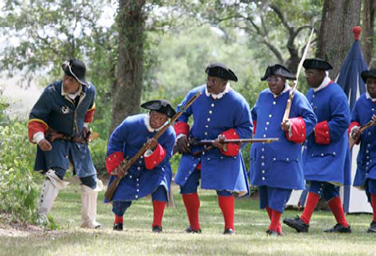Reenactors at Fort Mose Site State Historic Park portray black regimentals in the Battle of Bloody Mose.