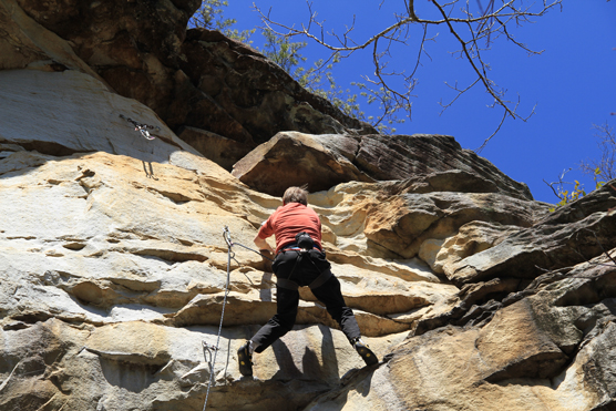 Climbing a rock face at the Obed.