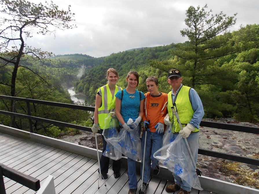 VIPs standing at the Lilly Bluff Overlook