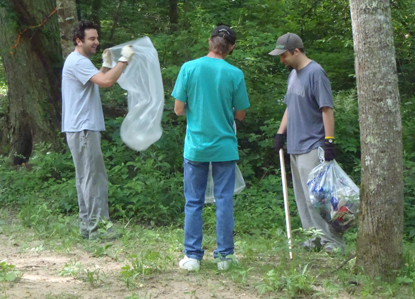 Park volunteers picking up trash.