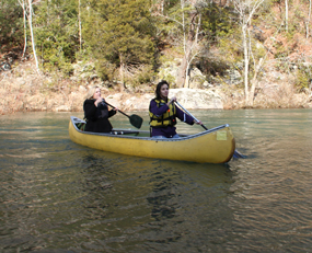 Two women canoeing on Clear Creek.