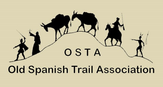 mules, a priest, a Spaniard, a trapper, an Indian travel the trail - logo