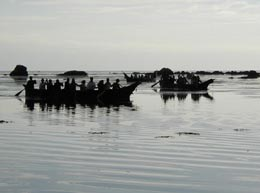 Two canoes out in the water at the start of the 2002 tribal journey