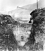 Historic photo of Glines Canyon Dam under construction.