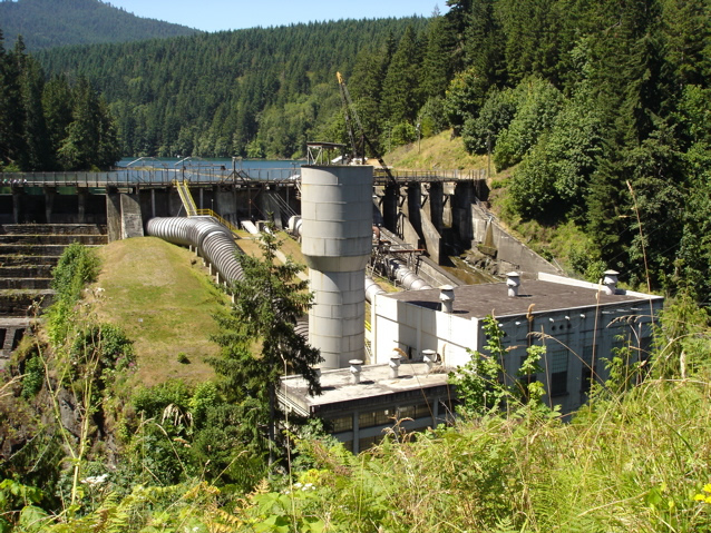 Elwha Dam, powerhouse and surge tower, with Lake Aldwell behind it.