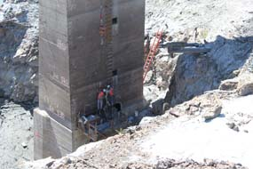 Worker prepare the intake tower at Glines Canyon Dam for removal.