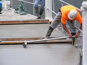 Pouring concrete on the walkway over the spillway.