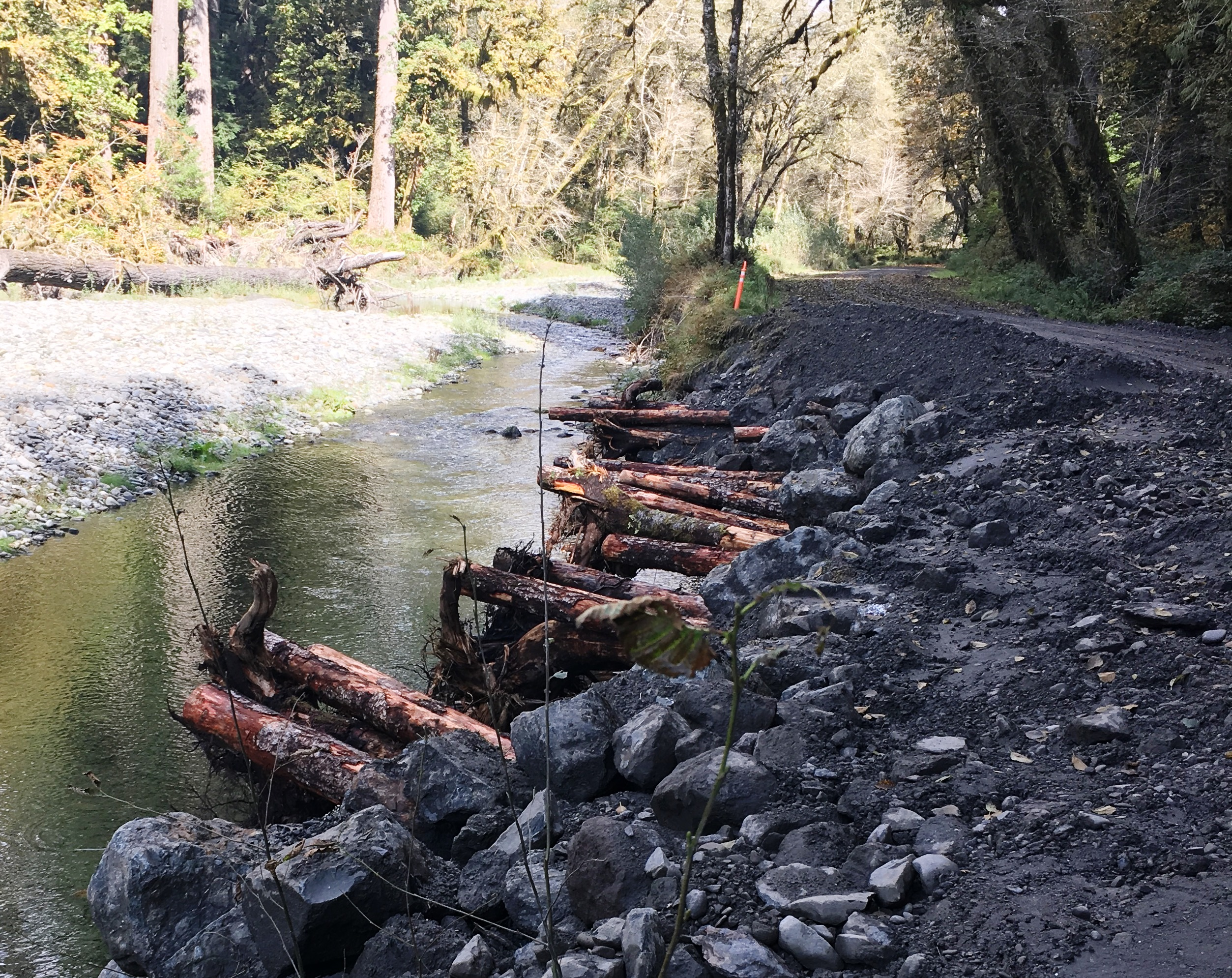 Road repair on a gravel road next to a river.