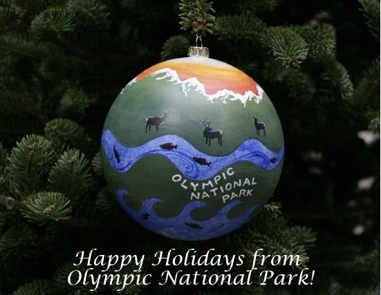 "ornament on tree with text ""Happy Holidays from Olympic National Park"""