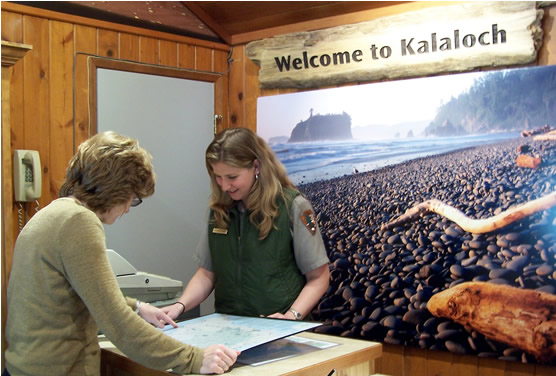 female ranger showing a map to visitor