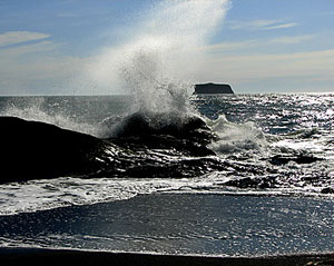 Waves crash on 3rd Beach in winter.