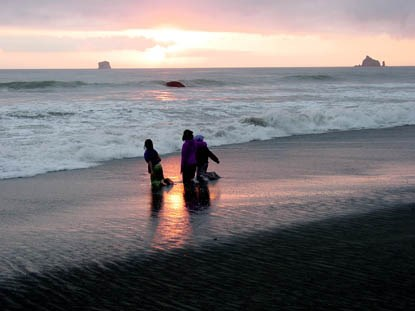 Three kids playing in surf