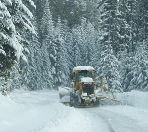 Plows work hard clearing snow on the road to Hurricane Ridge.