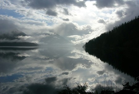 Thick clouds reflect upon the still waters of Lake Crescent.