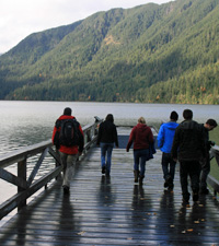 A group walking on the dock at Lake Crescent Lodge