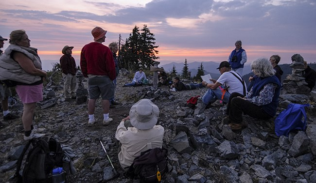 A group learns about the local history of early Oregon Caves pioneers.