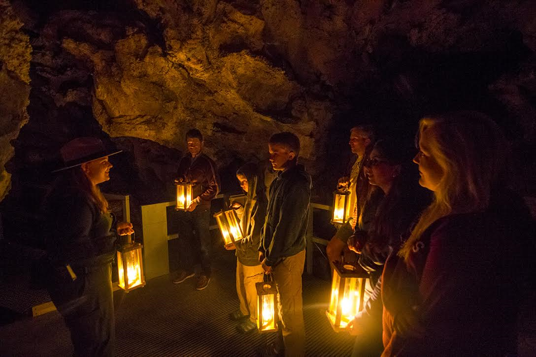 Tour group participating in a candlelight tour
