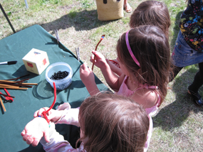 Children create their rock cycle bracelets during Rogue Valley Earth Day.