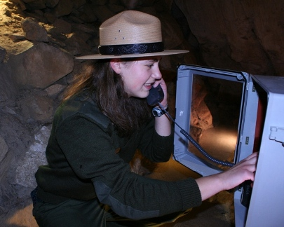 Heated, sealed enclosures protect cave phones from moisture.