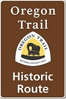 Brown Oregon NHT historic route sign with trail logo