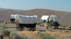 Photo image of emigrant wagons at Flagstaff Hill & the National Historic Oregon Trail Interpretive Center.