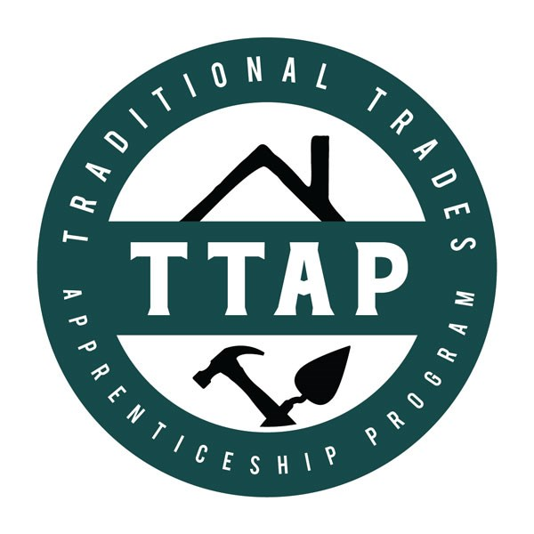 "Logo with the words ""Traditional Trades Apprenticeship Program"" around the outside, a house, and two tools within the logo."