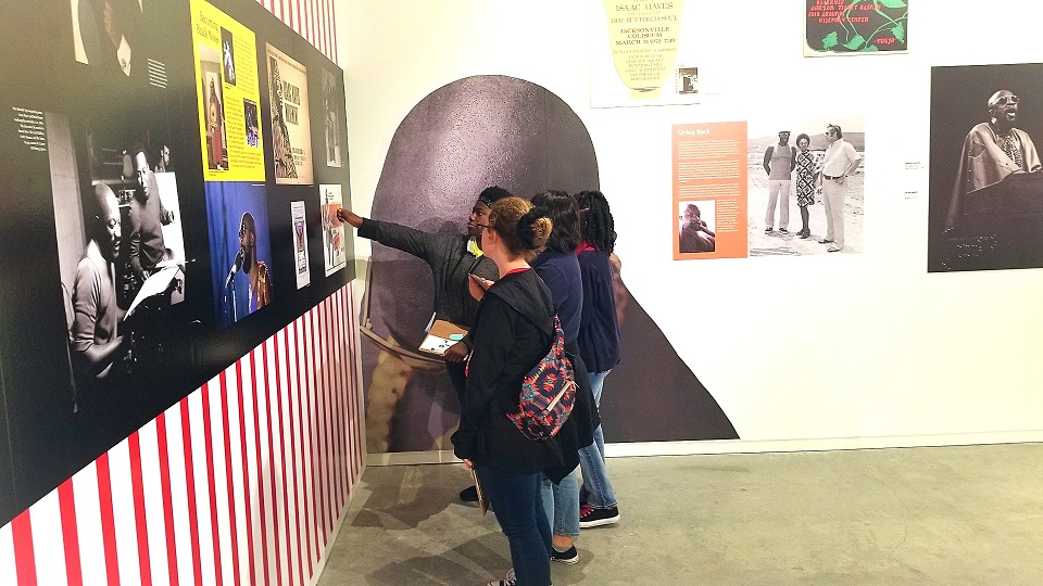 Four people looking at an exhibit at the world's only soul music museum